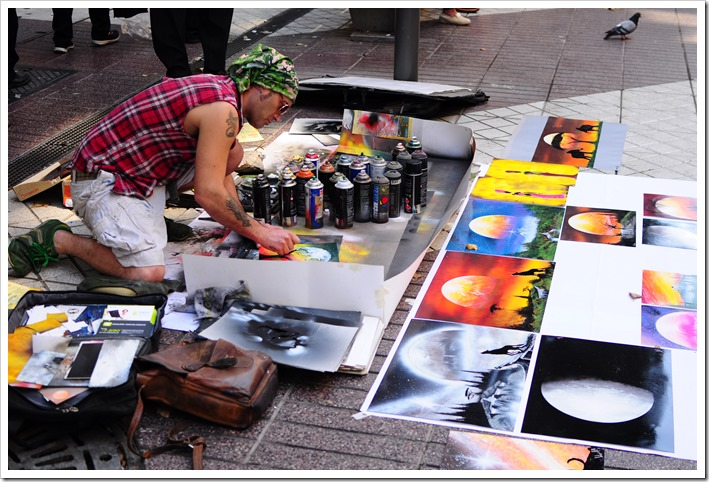 An artist at work in the Barrio Lastarria. Seeing artists at work always holds special attention for me. They are always engrossed in their art, and I get to maintain a discreet presence