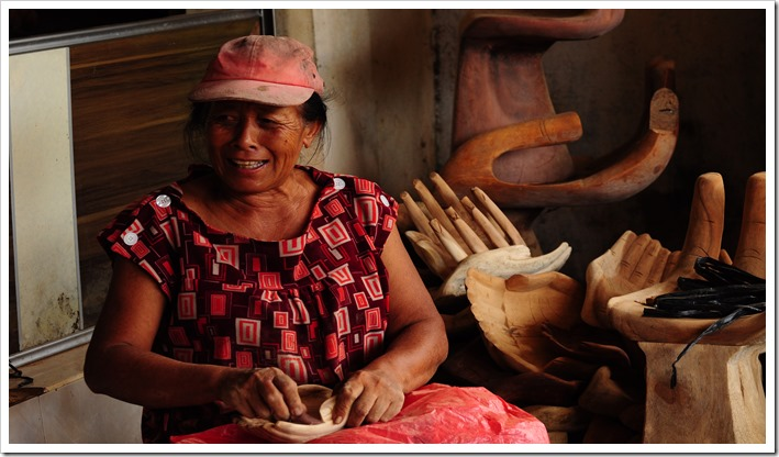 An artisan family carving wood in Petulu, Bali