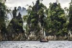 Tall jungle-covered cliffs dot a large part of the Cheow Lan lake